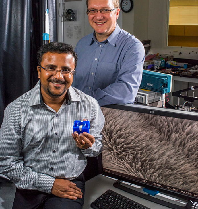 Vakhtang Putkaradze and Arindam Phani (seated), along with Thomas Thundat, have created a resonator with nanoscale features to detect dangerous chemicals in the environment.