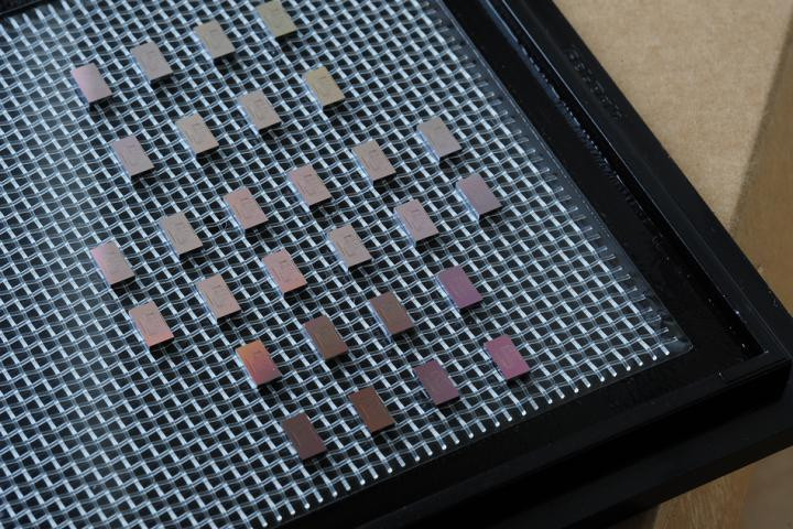 A collection of mini-spectrometer chips are arrayed on a tray after being made through conventional chip-making processes.  @ Felice Frankel