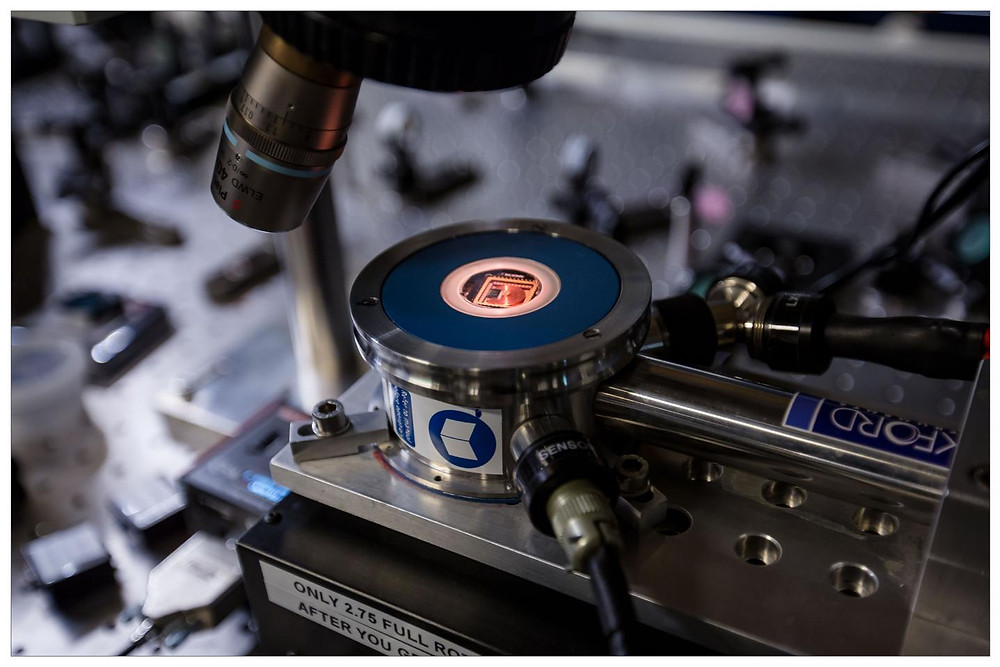 The research team has invented a component, called a nanomechanical router, that emits quantum information carried by light particles (photons) and routes them into different directions inside a photonic chip. Photonic chips are like computer microchips -- only, they use light instead of electrons. The component merges nano-opto-mechanics and quantum photonics -- two areas of research that, until now, have never been combined.  @ Ola Jakup