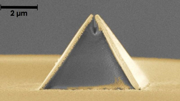 A new process called fiber nanoimprinting is accelerating the fabrication of nano-optical devices, such as this pyramid-shaped Campanile probe imprinted on an optical fiber (captured in a scanning electron microscope image). The gold layer is added after imprinting. The gap at the top is 70 nanometers wide, or 0.000002 inches or 100 times smaller than a single red blood cell. @ US Department of Energy