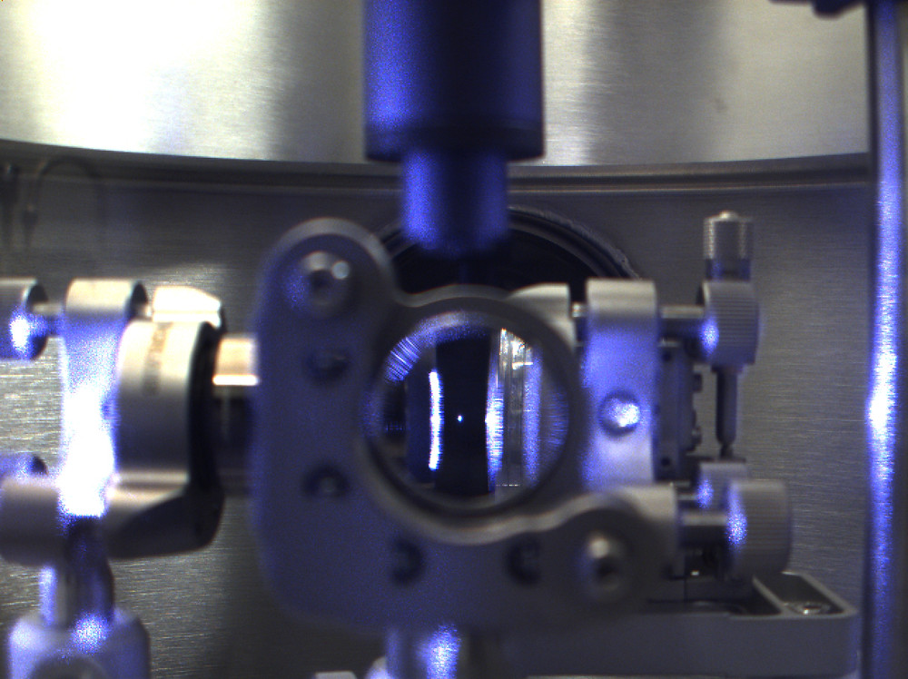 """This is a photo of a nanodiamond levitated in a vacuum chamber by Purdue University researchers who controlled its """"electron spin, """" an advance could find applications in quantum information processing, sensors and studies into the fundamental physics of quantum mechanics. (Purdue University image/Thai Hoang)"""