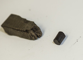 A sample of oil shale, left, and a kerogen pellet, right, extracted from shale by Rice engineers. Photo by Jeff Fitlow