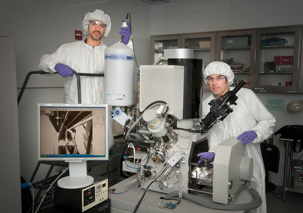 Matthew Sfeir (left) and Fernando Camino of the Center for Functional Nanomaterials use tools like this dual-beam system to investigate nanoscale materials.
