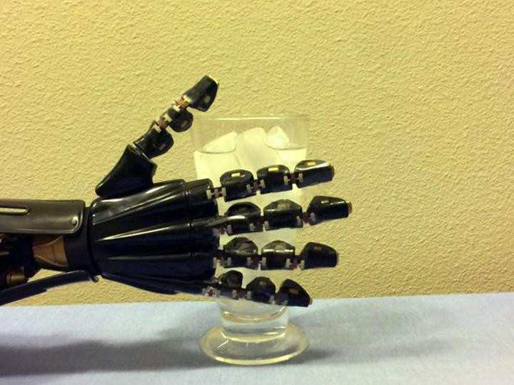 Researchers from the University of Houston have reported a breakthrough in stretchable electronics that can serve as an artificial skin, allowing a robotic hand to sense the difference between hot and cold. @ University of Houston