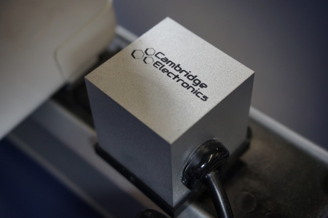 Shown here is a prototype laptop power adapter made by Cambridge Electronics using GaN transistors. At 1.5 cubic inches in volume, this is the smallest laptop power adapter ever made.  Courtesy of Cambridge Electronics