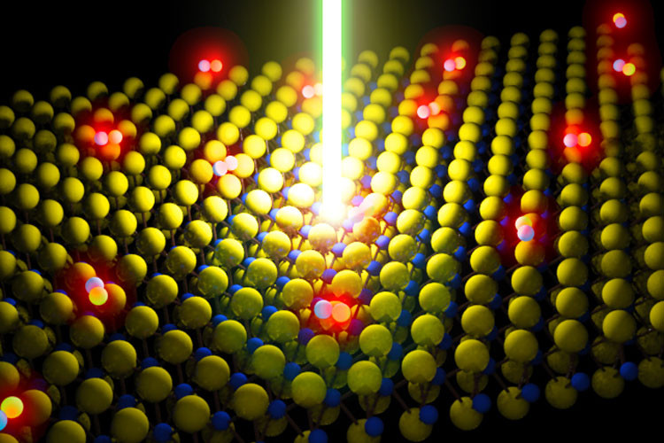 Schematic of a laser beam energizing a monolayer semiconductor made of molybdenum disulfide, or MoS2. The red glowing dots are particles excited by the laser. (Image by Der-Hsien Lien)