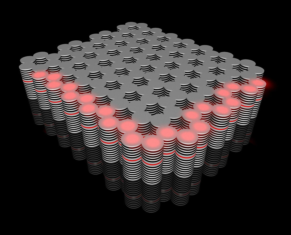 The novel topological insulator built in the Würzburg Institute of Physics: a controllable flow of hybrid optoelectronic particles (red) travels along its edges.  @ Karol Winkler