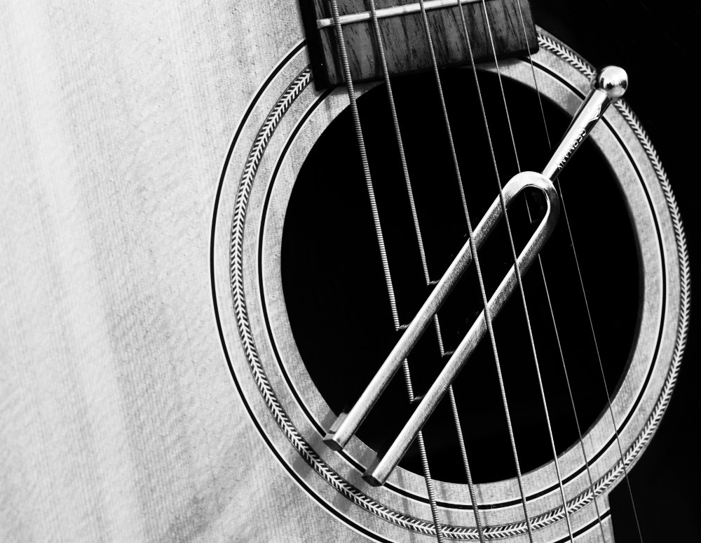 Like the classical tuning fork slung from guitar strings in this photo, scientists used a device that worked like a microwave tuning fork to switch a fundamental property of electrons on demand in a silicon-bismuth sample developed at Berkeley Lab. (Credit: Flickr/Pierre Guinoiseau)