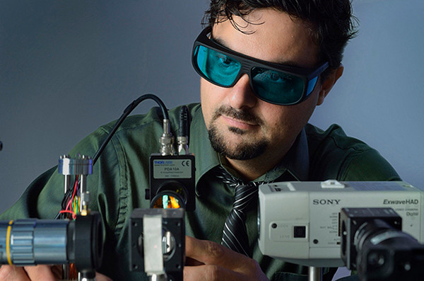 Nelson Sepulveda, associate professor of electrical and computer engineering, is leading a research team that is developing new uses for a smart material known as vanadium dioxide. Among the potential practical uses are for cell phone antennas and microsurgical devices. Photo courtesy of the MSU College of Engineering.