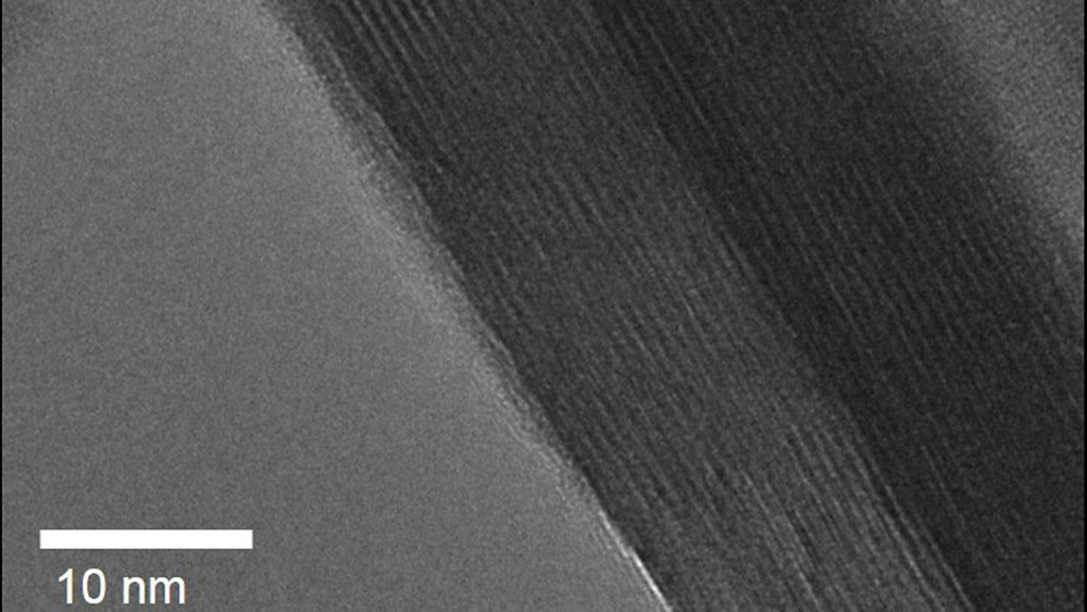 "Researchers at North Carolina State University have found that a material which incorporates atomically thin layers of water is able to store and deliver energy much more quickly than the same material that doesn't include the water layers. This is a low temperature high resolution transmission electron microscope image of a platelet of tungsten oxide dihydrate; the ""stripes"" are individual layers of atoms separated by water layers. @ Veronica Augustyn and James LeBeau"