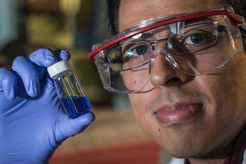 Rice graduate student Victor García-López holds a vial with millions of single-molecule nanosubmersibles. Photo by Jeff Fitlow
