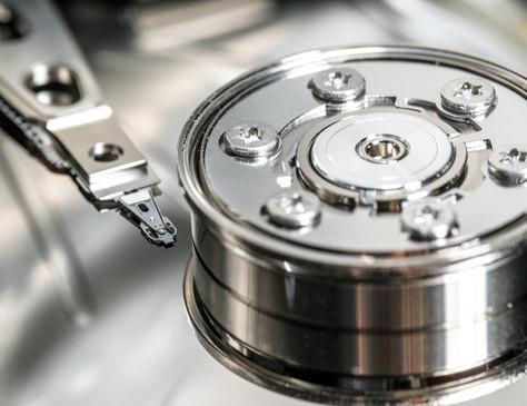 Storing data in single-atom magnets
