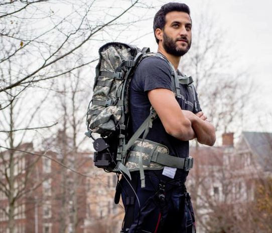 The multi-joint soft exosuit consists of textile apparel components worn at the waist, thighs and calves that guide mechanical forces from an optimized mobile actuation system attached to a rucksack via cables to the ankle and hip joints. In addition, a new tuning method helps personalize the exosuit's effects to wearers' specific gaits.  @ Wyss Institute at Harvard University