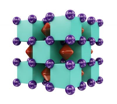 Crystal structure of Na2He, resembling a three-dimensional checkerboard. The purple spheres represent sodium atoms, which are inside the green cubes that represent helium atoms. The red regions inside voids of the structure show areas where localized electron pairs reside. @ Illustration is provided courtesy of Artem R. Oganov.