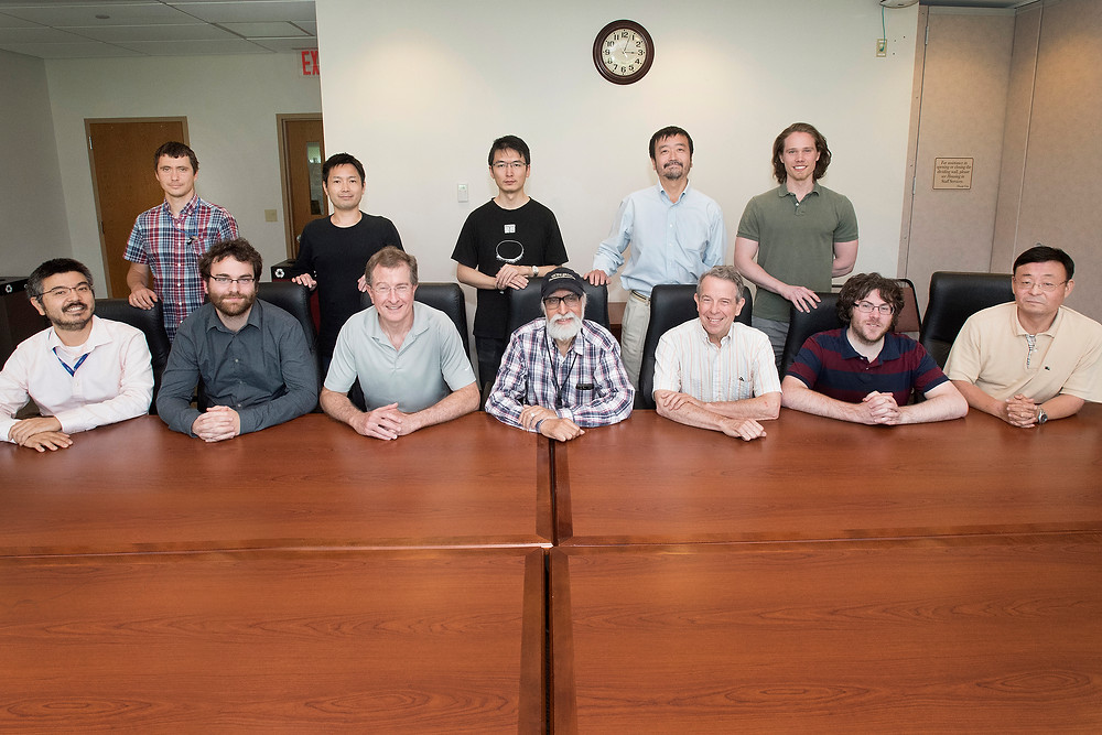 """Members of the """"RIKEN-Brookhaven-Columbia"""" Collaboration who participated in this work (seated L to R): Taku Izubuchi (RIKEN BNL Research Center, or RBRC, and Brookhaven Lab), Christoph Lehner (Brookhaven), Robert Mawhinney (Columbia University), Amarjit Soni (Brookhaven), Norman Christ (Columbia), Christopher Kelly (RBRC), Chulwoo Jung (Brookhaven); (standing L to R): Sergey Syritsyn (RBRC), Tomomi Ishikawa (RBRC), Luchang Jin (Columbia), Shigemi Ohta (RBRC), and Seth Olsen (Columbia). Mawhinney, Soni, and Christ were the founding members of the collaboration, along with Thomas Blum (not shown, now at the University of Connecticut)."""