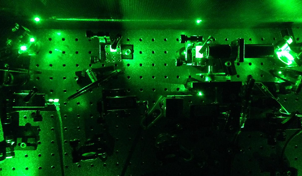 """An image from an experiment in the quantum optics laboratory in Cambridge. Laser light was used to excite individual tiny, artificially constructed atoms known as quantum dots, to create """"squeezed"""" single photons. CREDIT Mete Atature"""