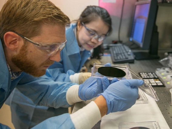 Researchers Eric Meshot, left, and Ngoc Bui evaluate the uniformity of a carbon nanotube array covering the entire area of a 4-inch wafer. Photos by Julie Rusell/LLNL.