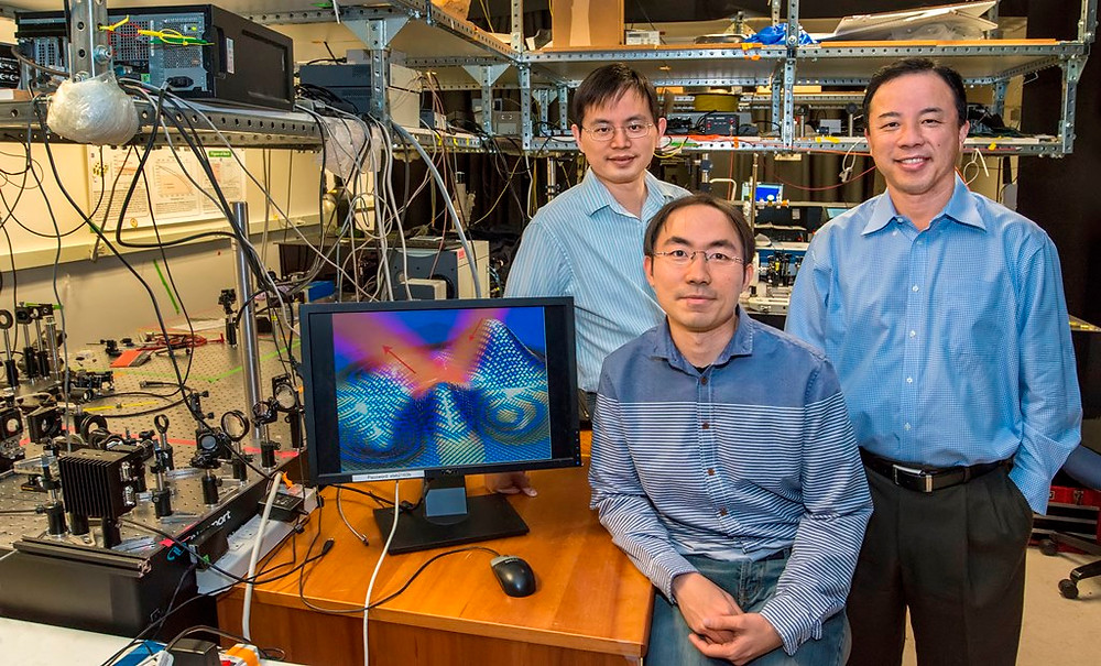 """(From left) Yuan Wang, Zi Jing Wong and Xiang Zhang have devised an ultra-thin invisibility """"skin"""" cloak that can conform to the shape of an object and conceal it from detection with visible light. (Photo by Roy Kaltschmidt)"""
