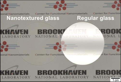 Glass surfaces with etched nanotextures reflect so little light that they become essentially invisible. This effect is seen in the above image, which compares the glare from a conventional piece of glass (right) to that from nanotextured glass (left), which shows no glare at all. @ Brookhaven National Laboratory
