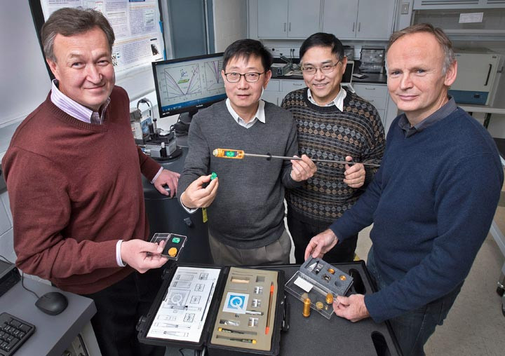 Nuclear theorist Dmitri Kharzeev of Stony Brook University and Brookhaven Lab with Brookhaven Lab materials scientists Qiang Li, Genda Gu, and Tonica Valla in a lab where the team measured the unusual high conductivity of zirconium pentatelluride.