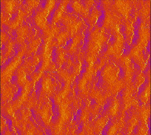 This is a microscope view of tiny buckyballs lined up on a layered graphene surface. New research shows that that electrically charged crinkles in the graphene surface are responsible for the strange phenomenon.  @  Kim Lab / Brown University