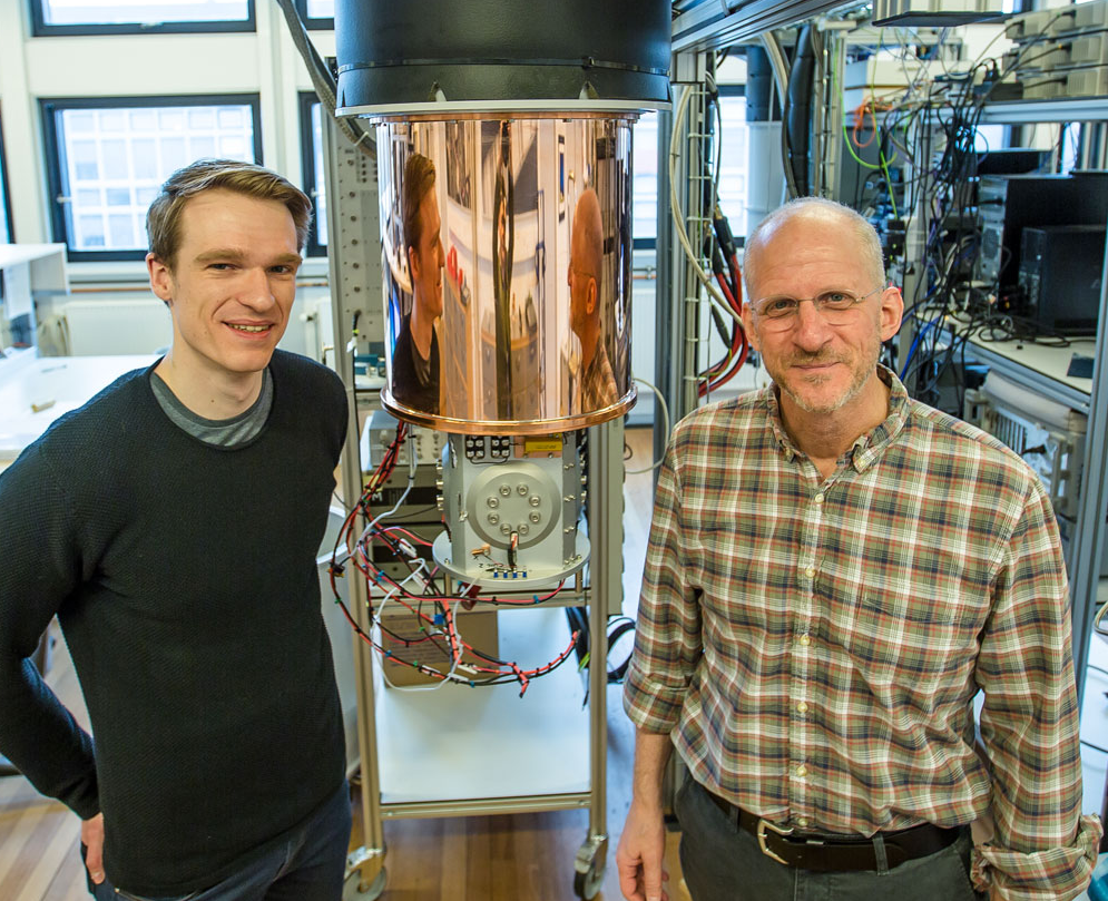 PhD Candidate Sven Albrecht and Professor Charles Marcus, Center for Quantum Devices (QDev) at the Niels Bohr Institute in Copenhagen. More than 80 researchers, graduate students and technicians work here at the research center in a huge building where top laboratories with advanced instruments for experiments have been built over two entire floors. (Credit: Ola Jakup Joensen, NBI)
