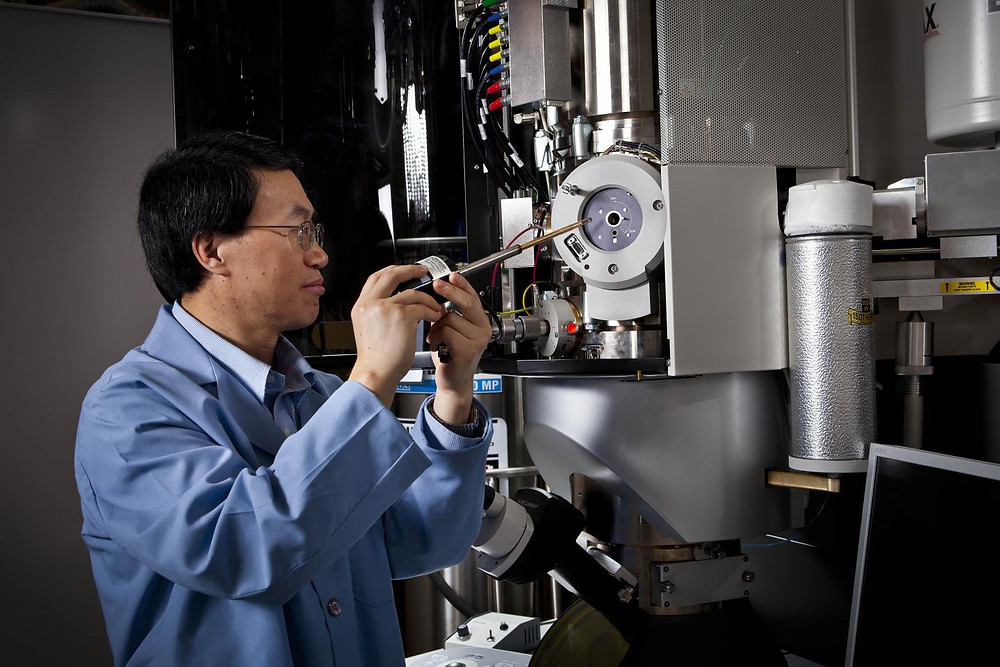 PNNL researcher Chongmin Wang and colleagues have developed the first step-by-step explanation of how a lithium-air battery forms bubbles, which expand the battery and create wear and tear that can cause it to fail. The research was aided by an environmental transmission electron microscope (shown here), which enabled the creation of a first-of-a-kind video that shows bubbles inflating and later deflating inside a nanobattery. @ Pacific Northwest National Laboratory