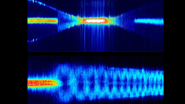 This technique directly images the propagation of light through an optical nanofiber, seen here as blue waves. The upper image is a zoomed out compilation of the Rayleigh scattering along the nanofiber. The saturated white section is the narrow neck of the nanofiber Images courtesy of the authors.