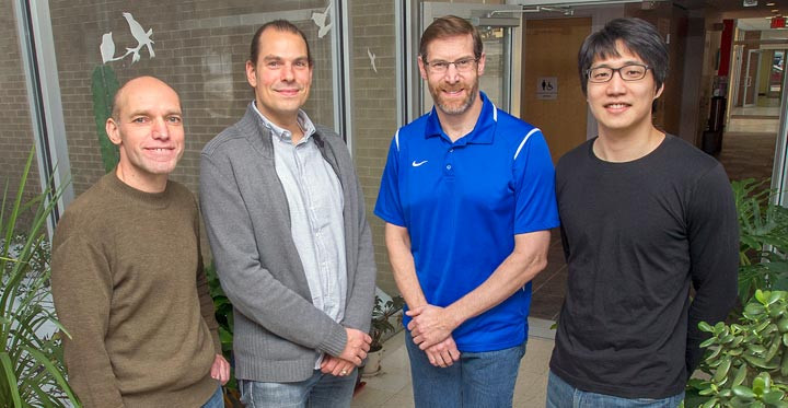 Brookhaven physicist Alexander Bazilevsky (far left) and Inseok Yoon of Seoul National University and the RIKEN BNL Research Center (far right), along with Hari Guragain of Georgia State University (not shown), led the analysis of the new gluon polarization results described in this story by RIKEN/RBRC physicist Ralf Seidl (center left) and John Lajoie of Iowa State University (center right). All are members of the PHENIX collaboration at the Relativistic Heavy Ion Collider (RHIC).