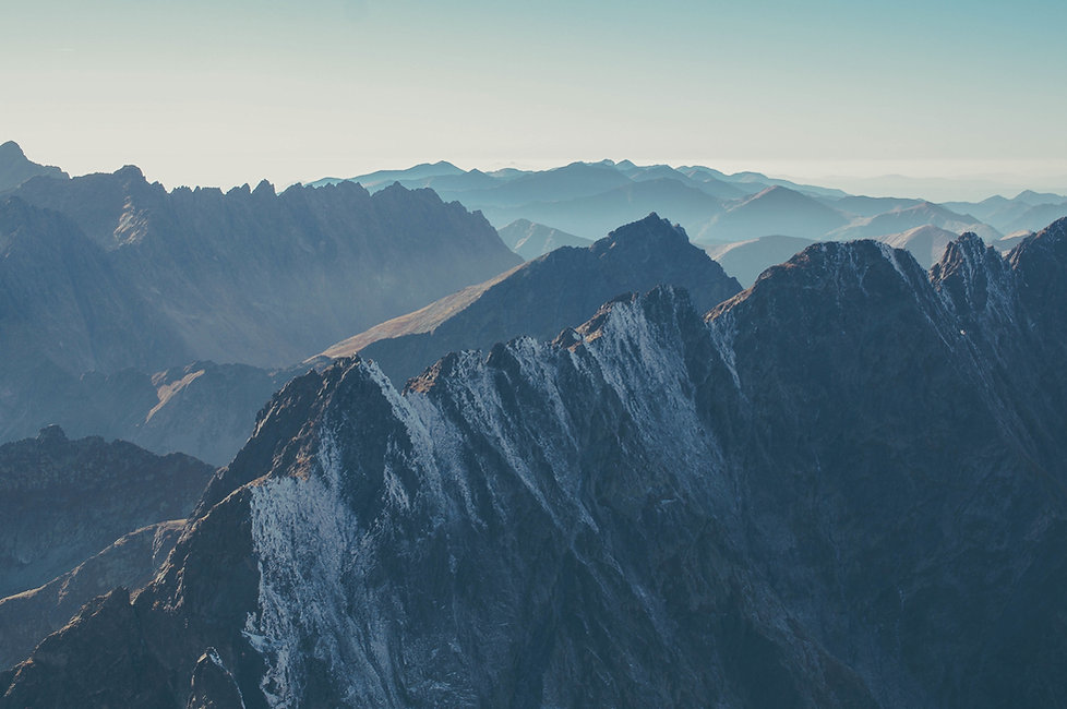 Slight snow covered mountains peaks