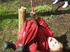 enjoying a swing at Forest School