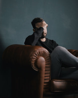 Thinking Man on Couch