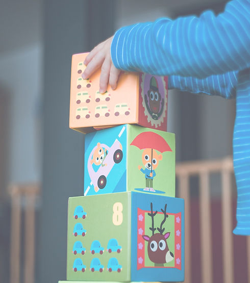 Child playing with blocks. Warm, friendly Counselling, Play Therapy & Creative Arts Therapy for Children, Young People & Adults.