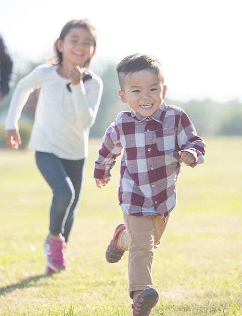 Happy children running – Warm & friendly Counselling, Psychotherapy and Mentoring Service for Children, Young People & Adults