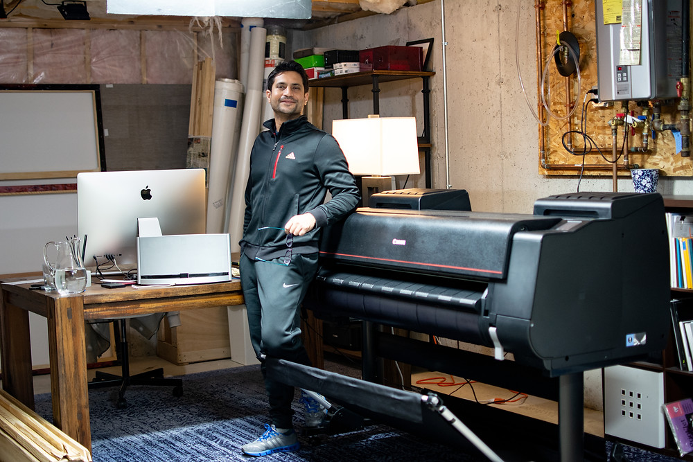 Siddharth Choudhary with his wide format inkjet printer at his studio in Boston.