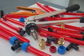 Water pipes PEX and mounting tools on th