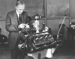 Henry Ford with V-8 flathead engine
