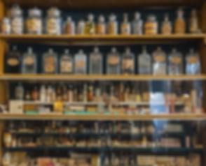 Empty scent bottles in old pharmacy.jpg