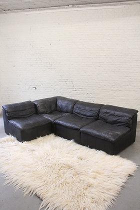 Modular black leather sofa, Laauser, '70s.