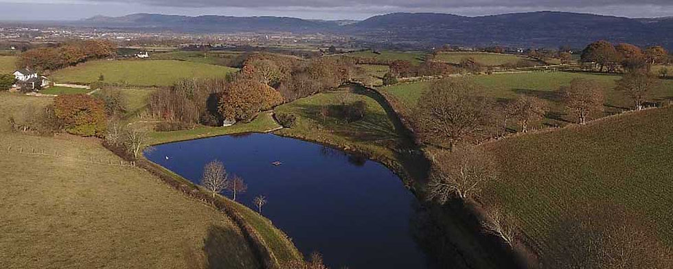 An aerial photo of Llyn Crud y Gwynt, near Denbigh North Wales. Controlled by Rhyl and St Asaph Angling Association, the lake offers fishing for brown and rainbow trout in peaceful surroundings 365 days of the year.