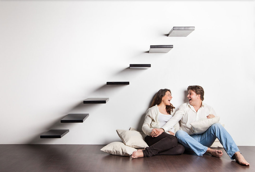 couple-home-sitting-stairs-pregnant-woman.jpg