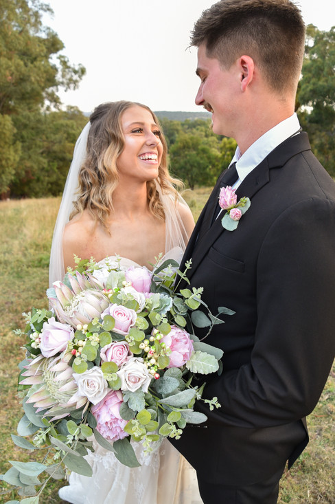 Happy Bride with her hired bouquet