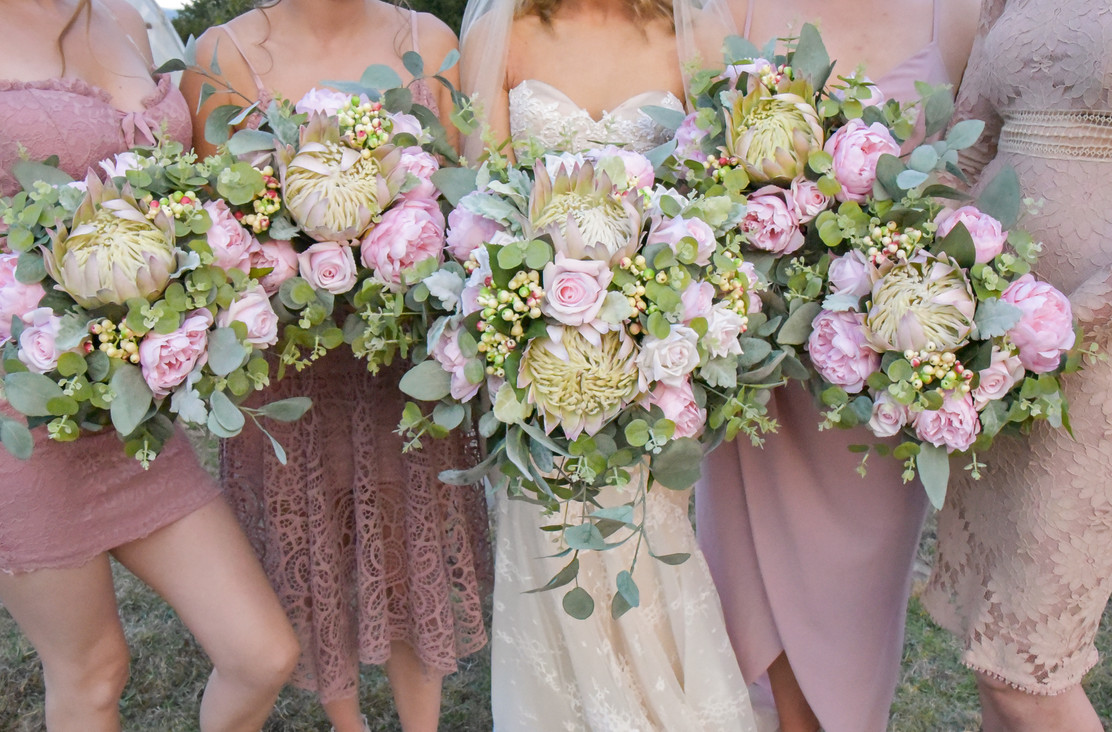 Bridal party with their bouquets for hire