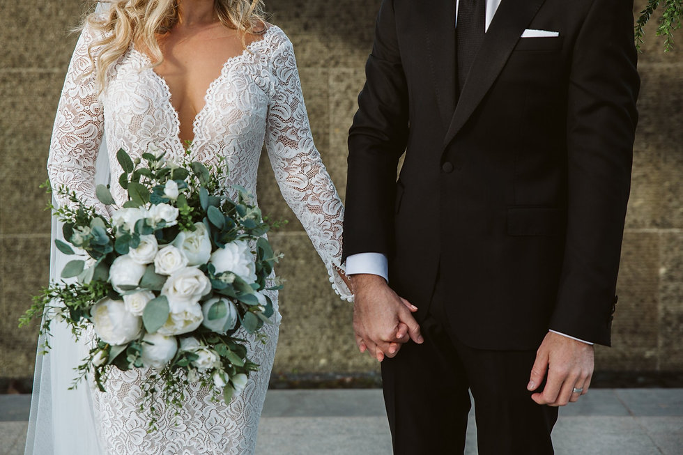 Beautiful Bride and Groom with their Stunning custom bouquet for their wedding ceremony.
