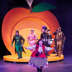 On stage as the Lady Bug in James and the Giant Peach with Big Noise Theatre.