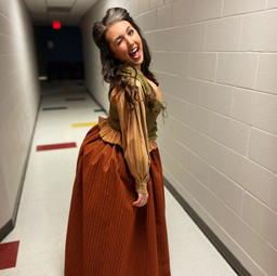 Backstage after a photo shoot as Bea Bottom in Something Rotten.