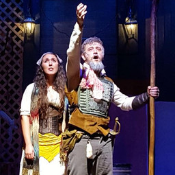 """Aldonza and Don Quijote on stage during the song """"Impossible Dream"""" in Man of La Mancha with MadKap Productions."""