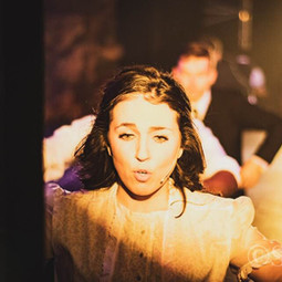 """On stage in the song """"Touch Me"""" as Wendla in Theatre Nebula's Spring Awakening."""