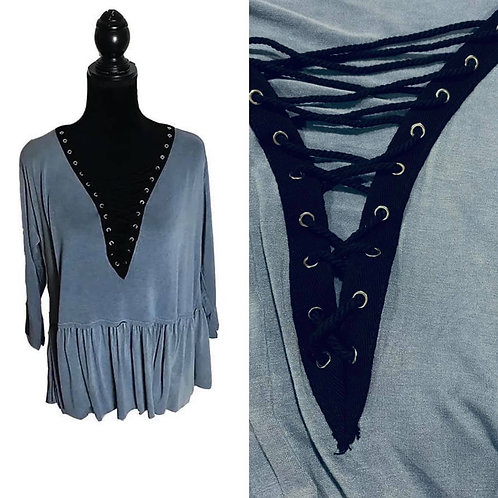 Light blue peplum top with lace up neckline in black