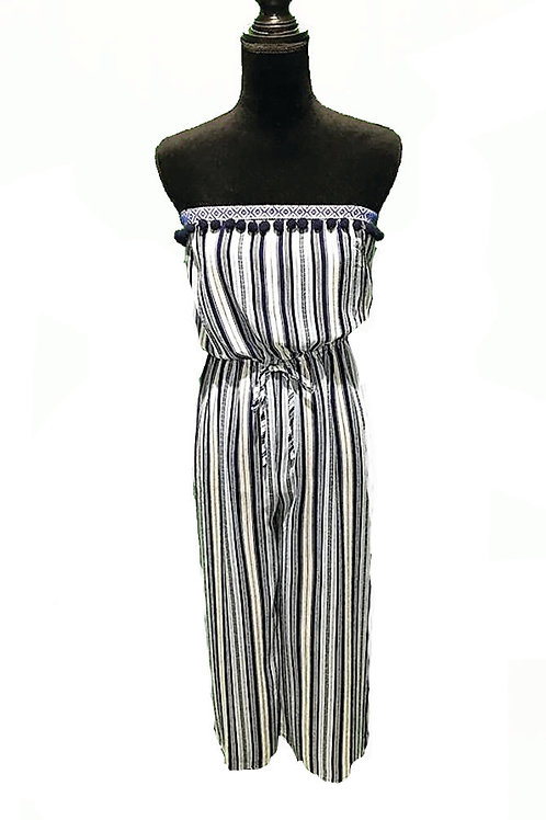 Navy and white striped strapless jumpsuit with bow tie waist and pom pom trim
